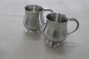 Pewter and Silver christening mugs
